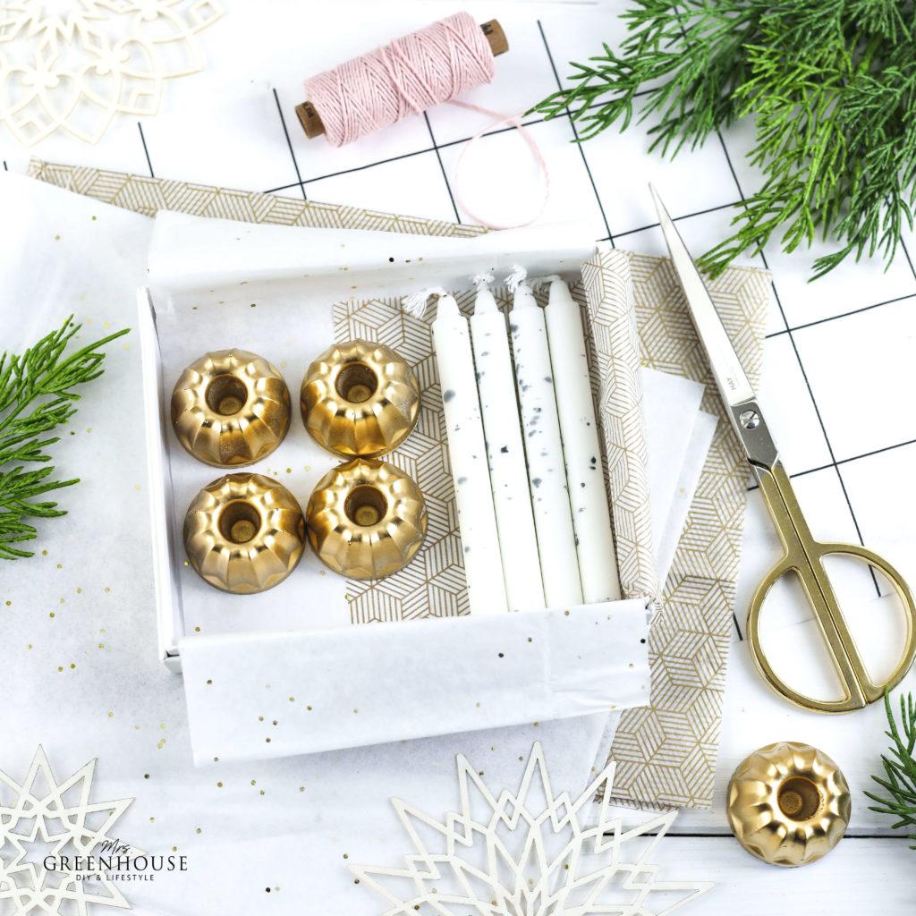 Kerzenständer aus Beton mit Goldspray verziert