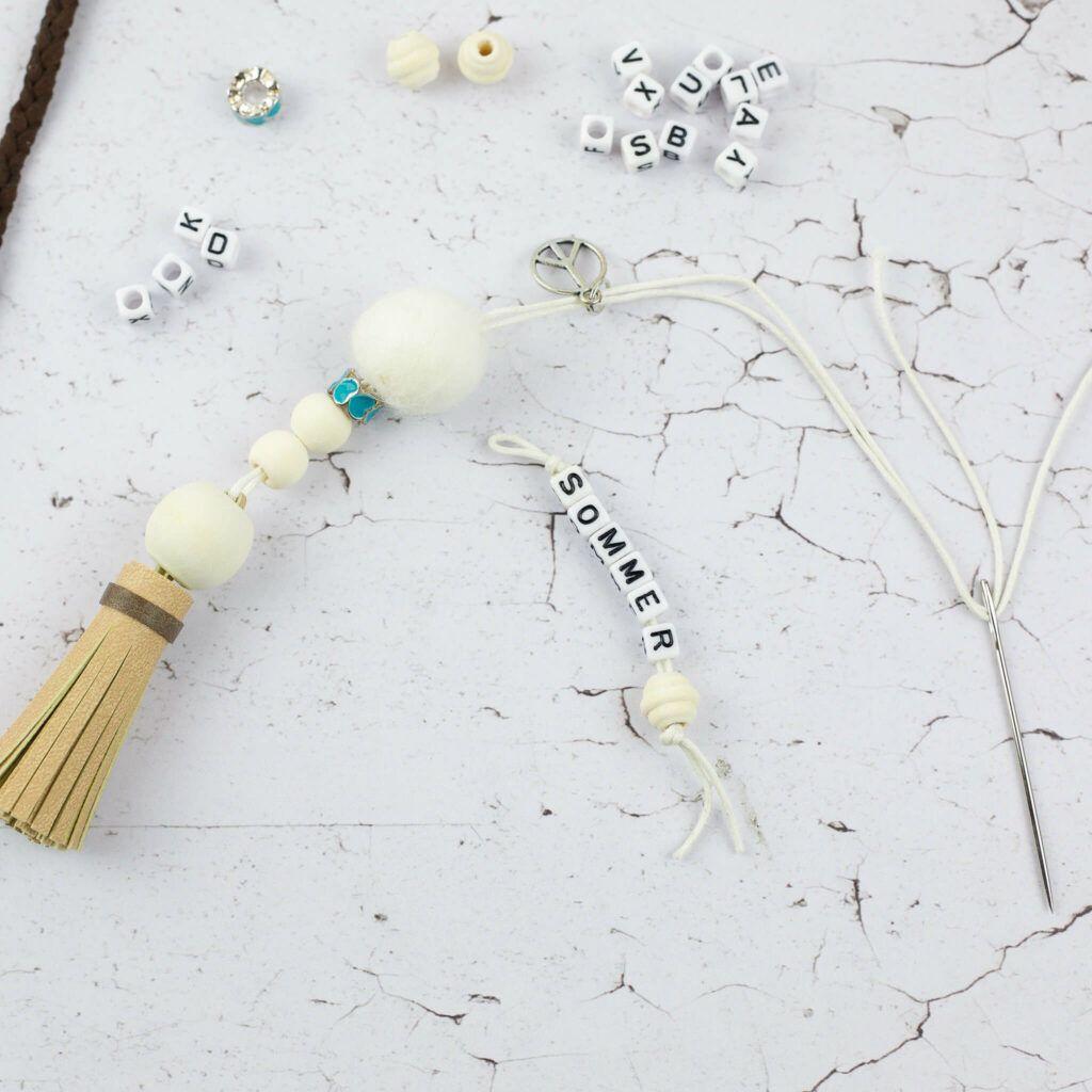 Boho Schlüsselanhänger mit Kunstleder Quasten
